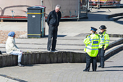 © Licensed to London News Pictures.04/04/2020. Brighton, UK. Police Community Support officers speak to members of the public on Brighton and Hove beach as the Coronavirus lock down ends its second week. Police is advising people not to sunbathe on the beach as the weather is becoming warmer. Photo credit: Hugo Michiels/LNP