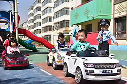 April 26, 2018 - Hohhot, Hohhot, China - Hohhot, CHINA-26th April 2018: Kids experience driving simulation at a kindergarten in Hohhot, north China's Inner Mongolia, April 26th, 2018. (Credit Image: © SIPA Asia via ZUMA Wire)
