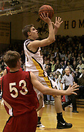 The Knights J.J. Laumann (3) shoots over the Lancers Danny Schmidt (53) as the LaSalle Lancers play the Alter High School Knights in varsity basketball, Friday Night, January 26, 2007, at Alter's Joe Petrocelli Gymnasium.