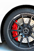Wheel, ventilated disc brakes and red calliper of AMG Mercedes SLS 6.3 at AMG showroom in Munich, Bavaria, Germany