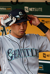 OAKLAND, CA - MAY 04: Norichika Aoki #8 of the Seattle Mariners stands in the dugout before the game against the Oakland Athletics at the Oakland Coliseum on May 4, 2016 in Oakland, California. The Seattle Mariners defeated the Oakland Athletics 9-8. (Photo by Jason O. Watson/Getty Images) *** Local Caption *** Norichika Aoki