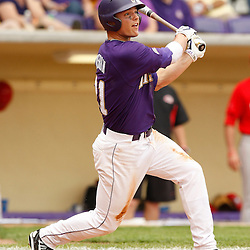 Apr 04, 2010; Baton Rouge, LA, USA; LSU Tigers batter Tyler Hanover (11) with a single against the Georgia Bulldogs at Alex Box Stadium. Mandatory Credit: Derick E. Hingle-US PRESSWIRE
