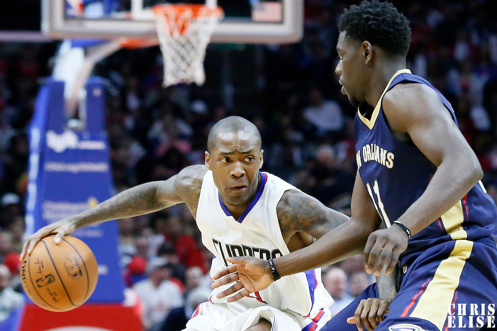 10 January 2016: New Orleans Pelicans guard Jrue Holiday (11) defends on Los Angeles Clippers guard Jamal Crawford (11) during the Los Angeles Clippers 114-111 overtime victory over the New Orleans Pelicans, at the Staples Center, Los Angeles, California, USA.