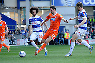 Blackpool's Chris Basham on the ball.  Skybet football league championship match , Queens Park Rangers v Blackpool at Loftus Road in London  on Saturday 29th March 2014.<br /> pic by John Fletcher, Andrew Orchard sports photography.