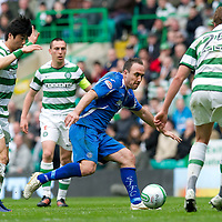 Celtic v St Johnstone....01.04.12   SPL<br /> Lee Croft is fouled by Ki Sung Yeung<br /> Picture by Graeme Hart.<br /> Copyright Perthshire Picture Agency<br /> Tel: 01738 623350  Mobile: 07990 594431