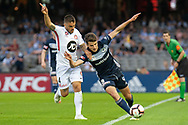 Melbourne Victory midfielder Terry Antonis (8)  competes for the ball against Western Sydney Wanderers defender Josh Risdon (4) at the Hyundai A-League Round 6 soccer match between Melbourne Victory and Western Sydney Wanderers at Marvel Stadium in Melbourne.