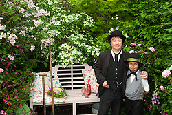 © Licensed to London News Pictures. 19/05/2014. London, England. 2 actors in Victorian costumes at the Hillier Nurseries and Garden Centres stand. Press Day at the RHS Chelsea Flower Show. On Tuesday, 20 May 2014 the flower show will open its doors to the public.  Photo credit: Bettina Strenske/LNP