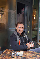 man enjoying time at an outdoor cafe in New York