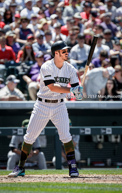 SHOT 5/28/17 1:09:32 PM - The Colorado Rockies Nolan Arenado #28 prepares to hit against the St. Louis Cardinals  during their regular season MLB game at Coors Field in Denver, Co. The Rockies won the game 8-4. (Photo by Marc Piscotty / © 2017)