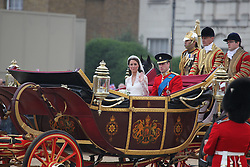 LOCATION, UK  29/04/2011. The Royal Wedding of HRH Prince William to Kate Middleton. .The Wedding Procession of Prince William and Kate Middleton passes through Horseguards Parade..Photo credit should read CRAIG SHEPHEARD/LNP. Please see special instructions. © under license to London News Pictures