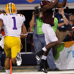 Jan 7, 2011; Arlington, TX, USA; Texas A&M Aggies wide receiver Uzoma Nwachukwu (7) catches a touchdown past LSU Tigers cornerback Eric Reid (1)during the second quarter of the 2011 Cotton Bowl at Cowboys Stadium.  Mandatory Credit: Derick E. Hingle