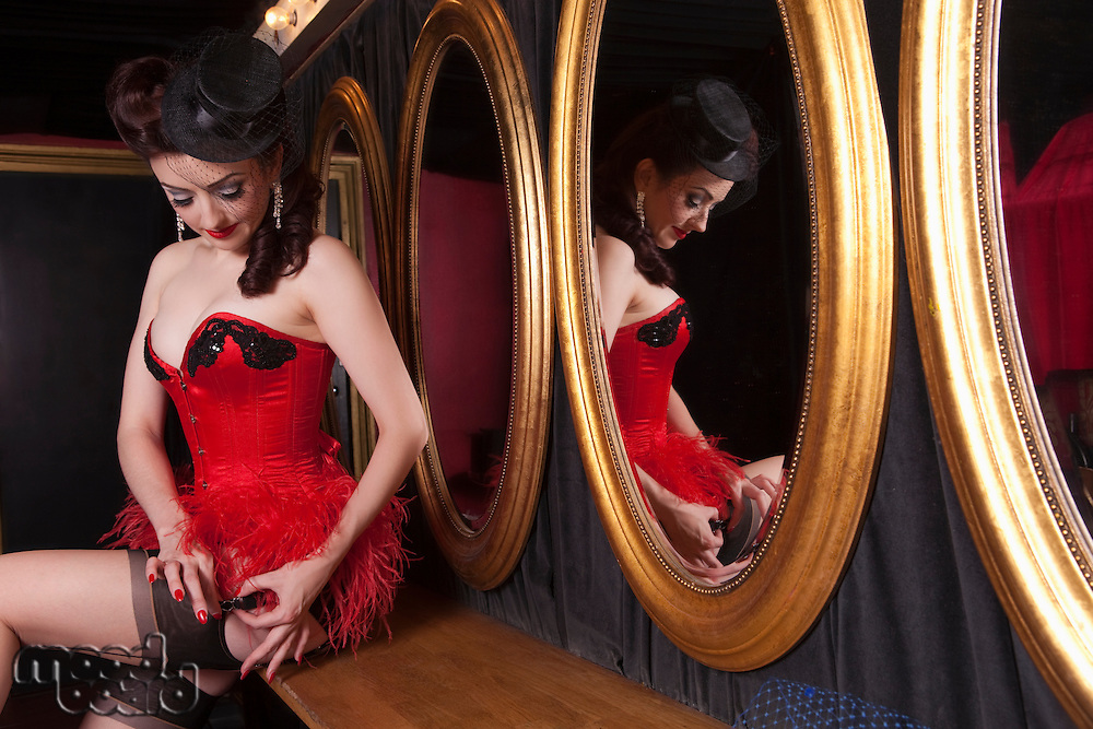 Showgirl putting on suspenders