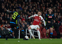 Football - 2018 / 2019 UEFA Europa League - Quarter Final, First Leg Arsenal vs. Napoli <br /> <br /> Kalidou Koulibaly (Napoli) and Mesut Ozil (Arsenal FC) tackle for the ball at The Emirates.<br /> <br /> COLORSPORT/DANIEL BEARHAM