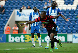 Peterborough United's Gabriel Zakuani celebrates scoring his goal  - Photo mandatory by-line: Joe Dent/JMP - Tel: Mobile: 07966 386802 06/08/2013 - SPORT - FOOTBALL - Weston Homes Community Stadium - Colchester -  Colchester United V Peterborough United - Capital One Cup - First Round