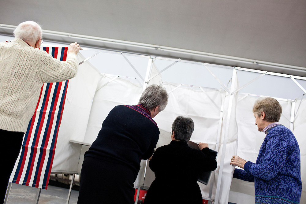 Mac Warren, Bonnie Haubrich, Susan Frost, and Dorothy Campbell, from left, assemble voting booths for primary voting at the Grafton Fire Station on Tuesday, January 10, 2012 in Grafton, NH. Brendan Hoffman for the New York Times