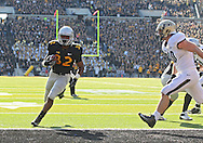 November 10 2012: Iowa Hawkeyes running back Damon Bullock (32) scores on a 1 yard touchdown run during the NCAA football game between the Purdue Boilermakers and the Iowa Hawkeyes at Kinnick Stadium in Iowa City, Iowa on Saturday, November 10, 2012. Purdue defeated Iowa 27-24.