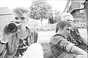 Three youths lying on the grass, UK, 1980s