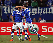 Jefferson Farfan, Raul and  Sergio Escudero celebrate during the UEFA Champions League round of 16 second leg match between Schalke 04 and Valencia at Veltins Arena on March 9, 2011 in Gelsenkirchen, Germany.
