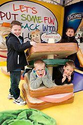 The Kingsmill Big Lunch Tour reaches Sheffield and puts the fun back into lunchtimes as Josh Brown (left) and Rylan Fox (right) make a sandwich out of Harvey Hewat and Jake Fox in the Kingsmill Playzone in Fargate Sheffield on Wednesday...http://www.pauldaviddrabble.co.uk.11 April 2012 .Image © Paul David Drabble