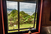 Martins Bay Hut has a scenic location overlooking the Tasman Sea, but beware the clouds of biting sandflies. Hollyford Track, Fiordland National Park, Southland region, South Island of New Zealand. We enjoyed an easy 3-day version of the Hollyford Track: Day 1: fly from Milford Sound to Martins Bay, walk to its oceanfront Hut, and see New Zealand fur seals. Day 2: jetboat on Lake McKerrow to Pyke River Confluence, hike to Hidden Falls Hut for overnight lodging. Day 3: tramp out to Hollyford Road end to our prearranged car shuttle. In 1990, UNESCO honored Te Wahipounamu - South West New Zealand as a World Heritage Area.
