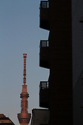 Tokyo Skytree at dusk seen behind the balconies of an apartment building in Asakusa, Tokyo, Japan. Monday April 15th 2019
