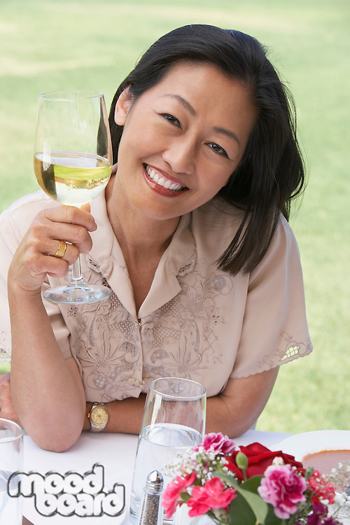 Woman sitting holding wine glass