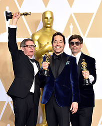 March 4, 2018 - Los Angeles, California, USA - 3/4/18.Jeffrey A. Melvin, Paul Denham Austerberry and Shane Vieau winners of the award for Best Production Design for ''The Shape Of Water'' at the 90th Annual Academy Awards (Oscars) presented by the Academy of Motion Picture Arts and Sciences..(Hollywood, CA, USA) (Credit Image: © Starmax/Newscom via ZUMA Press)