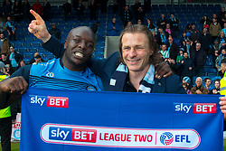 Adebayo Akinfenwa of Wycombe Wanderers and Wycombe Wanderers manager Gareth Ainsworth hold up a Sky Bet banner - Mandatory by-line: Ryan Crockett/JMP - 28/04/2018 - FOOTBALL - Proact Stadium - Chesterfield, England - Chesterfield v Wycombe Wanderers - Sky Bet League Two