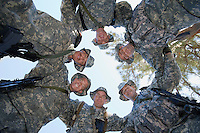 Low angle portrait of soldiers standing in circle