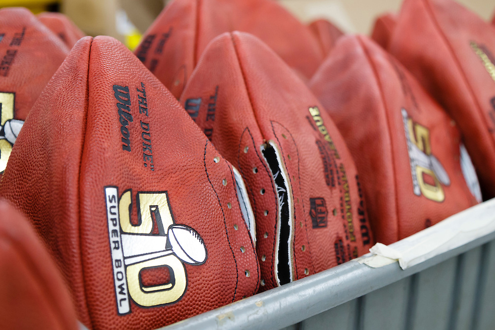 Official balls for the NFL Super Bowl 50 football game wait to be laced at the Wilson Sporting Goods Co. in Ada, Ohio, Tuesday, Jan. 26, 2016. The Denver Broncos will play the Carolina Panthers in the Super Bowl on Feb. 7 in Santa Clara, CA. (AP Photo/Rick Osentoski)