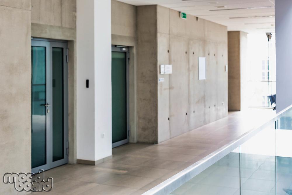 Photo of empty school corridor interior building