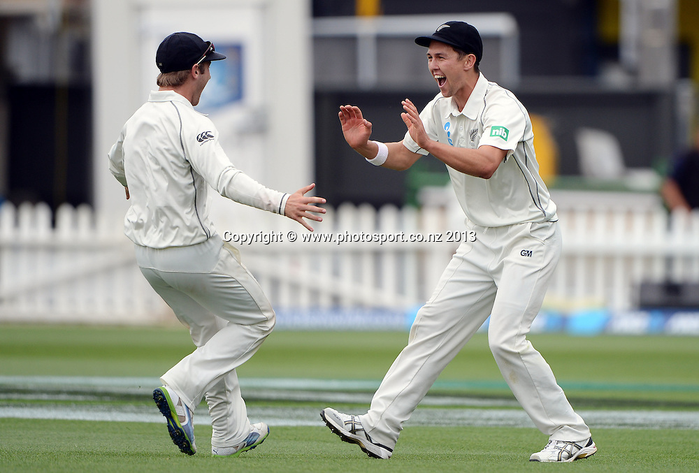 Trent Boult celebrates taking a spectacular catch to dismiss Denesh Ramdin on Day 3 of the 2nd cricket test match of the ANZ Test Series. New Zealand Black Caps v West Indies at The Basin Reserve in Wellington. Friday 13 December 2013. Mandatory Photo Credit: Andrew Cornaga www.Photosport.co.nz