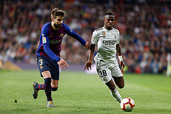 March 2, 2019 - Madrid, Spain - Real Madrid CF's Vinicius Jr and FC Barcelona's Gerard Pique during La Liga match between Real Madrid and FC  Barcelona at Santiago BernabÈu in Madrid..Final Score: Real Madrid 0 - 1 FC Barcelona (Credit Image: © Manu Reino/SOPA Images via ZUMA Wire)