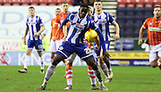 Wigan Defender Leon Barnett battles during the Sky Bet League 1 match between Wigan Athletic and Blackpool at the DW Stadium, Wigan, England on 12 December 2015. Photo by Pete Burns.