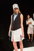 An off-white skirt with pleats and slits and a black wrap top over a powder blue sleeveless T. By Monika Chiang at Spring 2013 Fashion Week in New York.