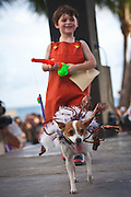 A costumed participant with her dog during the Pet Masquerade at  the annual Fantasy Fest Key West, Florida.
