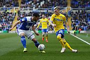 Leeds United midfielder Ezgjan Alioski (10) goes past Birmingham City defender Maxime Colin  during the EFL Sky Bet Championship match between Birmingham City and Leeds United at St Andrews, Birmingham, England on 6 April 2019.