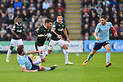 Graham Carey (10) of Plymouth Argyle is fouled by Mark Hughes (3) of Accrington Stanley during the EFL Sky Bet League 1 match between Plymouth Argyle and Accrington Stanley at Home Park, Plymouth, England on 22 December 2018.