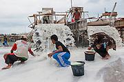Miners work in in tin mine on the road to Pemali. Bangka Island (Indonesia) is devastated by illegal tin mines. The demand for tin has increased due to its use in smart phones and tablets.<br /> <br /> Mine d'étain illégale sur la route de Pemali.   <br /> L'île de Bangka (Indonésie) est dévastée par des mines d'étain sauvages. la demande de l'étain a explosé à cause de son utilisation dans les smartphones et tablettes.