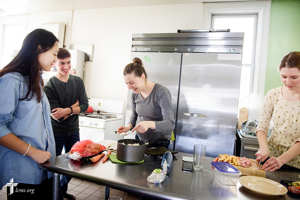Rebecca Wagner (center), LCMS national missionary, prepares lunch with (L-R) Fiona, an international student, Andrew Kind, and Bekah Zimmerman, a student studying Japanese, on Wednesday, Feb. 21, 2018, at Luther House next to the University of Minnesota, Twin Cities, in Minneapolis. Wagner serves alongside The Rev. Kind at University Lutheran Chapel and focuses on outreach to international students.  LCMS Communications/Erik M. Lunsford