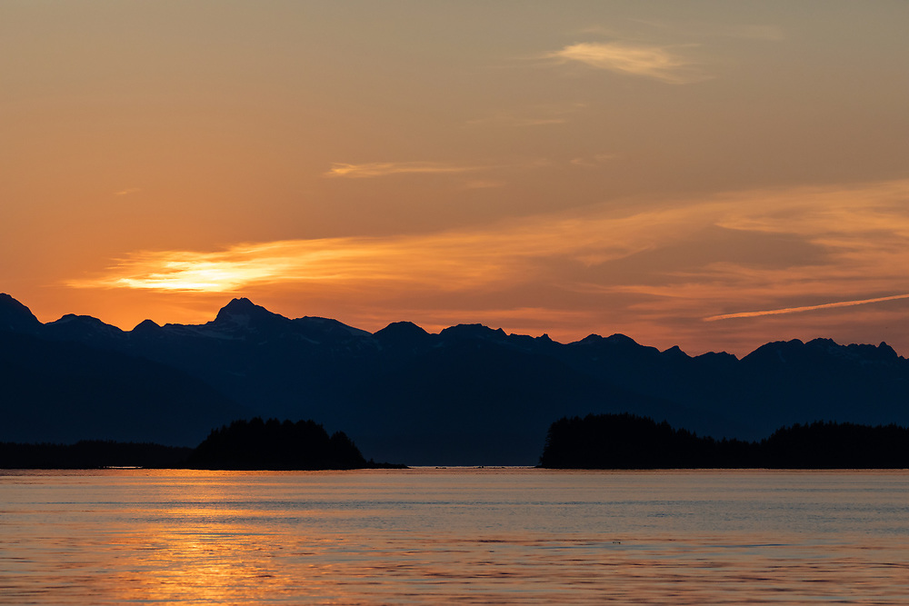 Alpenglow over the Chilkat Range in Southeast Alaska. Summer.