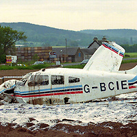 Air crash...27.5.99.<br />Police  at the scene of the air crash with farm building and the A94 Perth to Forfar road in the background.<br /><br />Picture Copyright:  John Lindsay / Perthshire Picture Agency.<br />Tel. office 01738 623350. mobile 07775 852112