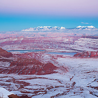Late twilight across snow covered Dead Horse Point State Park and Moab, UT