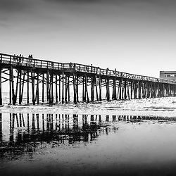 Newport Beach Pier panoramic photo in black and white. Panoramic photo ratio is 1:3. Newport Pier is located along the Pacific Ocean on Balboa Peninsula in Newport Beach, Orange County, California.