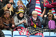Wasps supporters wrapped up and covered by blankets during the Aviva Premiership match between Wasps and London Irish at the Ricoh Arena, Coventry, England on 4 March 2018. Picture by Dennis Goodwin.
