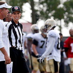 Aug 3, 2013; Metairie, LA, USA; NFL official female trainee Sarah Thomas stands next to New Orleans Saints head coach Sean Payton during a scrimmage at the team training facility. Mandatory Credit: Derick E. Hingle-USA TODAY Sports