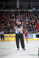 KELOWNA, CANADA - NOVEMBER 21: Referee Brett Iverson stands on the ice wearing a CHL officials Movember fundraiser jersey at the Kelowna Rockets play the against the Portland Winterhawks on November 21, 2014 at Prospera Place in Kelowna, British Columbia, Canada.  (Photo by Marissa Baecker/Shoot the Breeze)  *** Local Caption *** Brett Iverson;
