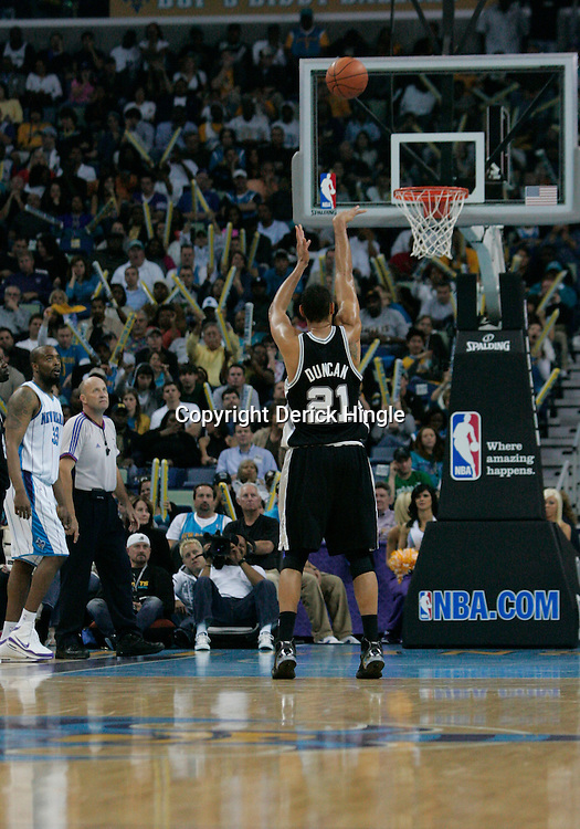 29 March 2009: San Antonio Spurs center Tim Duncan (21) shoots a free throw during a 90-86 victory by the New Orleans Hornets over Southwestern Division rivals the San Antonio Spurs at the New Orleans Arena in New Orleans, Louisiana.