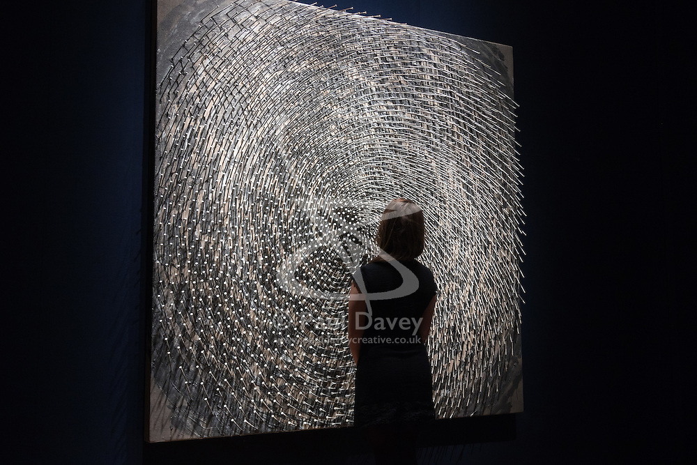 Christie's, London, March 3rd 2017. PICTURED: A woman admires Gunther Uecker's 'Spirale I, Spirale II (Doppelspirale), nails and latex paint on canvas laid down on wood, in two parts, accompanied by an artist's architectural drawing, which is expected to fetch between £1-1.5 million. <br /> Fine art auctioneers Christies hold a press preview for their Post-War and Contemporary Art auctions to be held on March 7th and 8th.