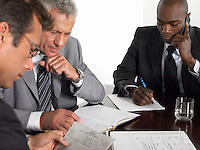 Three businessmen in conference meeting